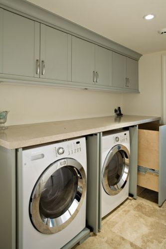 Great laundry room idea - folding counter, then shorter cabinets above