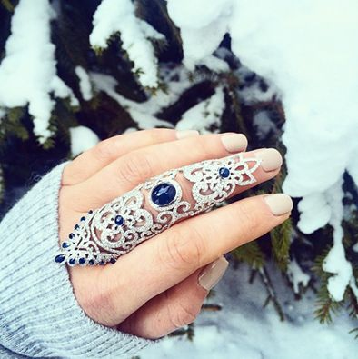 Full finger ring in diamonds and sapphire cabochons.