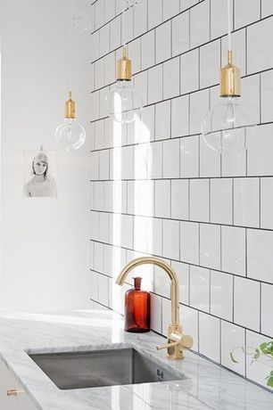 Eclectic Kitchen with Delta Trinsic Single-Handle Pull-Down Sprayer Kitchen Faucet, Arteriors Home 1 Light Mini Pendant