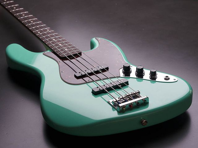 Surf Green Jazz Bass. Body and neck by Warmoth. Alder w/ maple & rosewood. Tortoise pick guard, Lindy Fralin pickups, Gotoh 201 bridge.