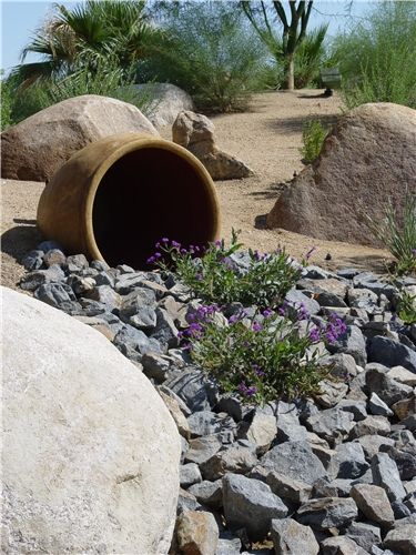 "One of the most common ways of unifying boulders is to create a steam bed-like ""flow"" of smaller stone."