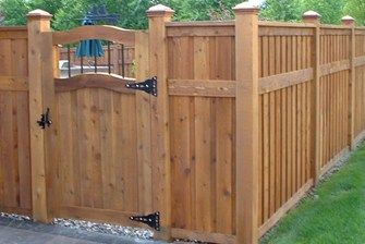 This fence's secondary stringer or horizontal accent breaks up the vertical lines turning it into two differing sized panels for greater interest.