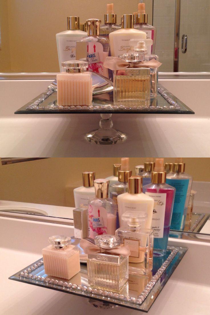 DIY perfume vanity. Using a glass pillar candle holder, super glued under a mirrored candle tray. #perfumetray #vanity #diy