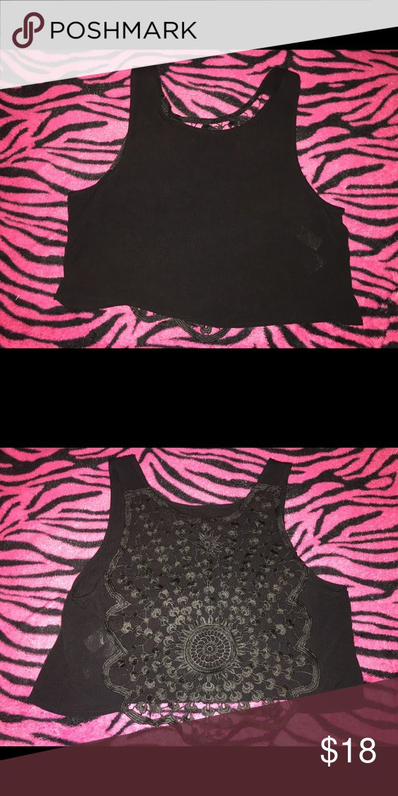 H&M black crop top Black crop top with cut out design on back. Never worn. NWOT. Great for casual wear. Size 8 but could possibly fit like a M or L H&M Tops Crop Tops