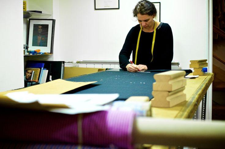 Dora, of Simon Skottowe Bespoke Tailors, at the work table.