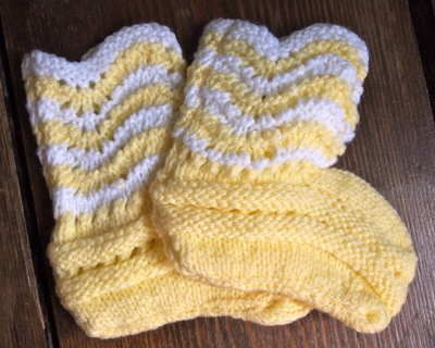 Vintage Hand Knitted Yellow  White Booties 5.00 Beautiful hand knitted yellow and white booties, with a scalloped edge detail.  Size 0-6 months  Coordinate with some of our childrens accessories