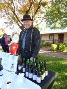 A Barossa local stands in front of a stall selling vincotto at the Vintage Festival Ziegenmarkt * Read about it at TIFFIN - bite sized food & travel adventures -