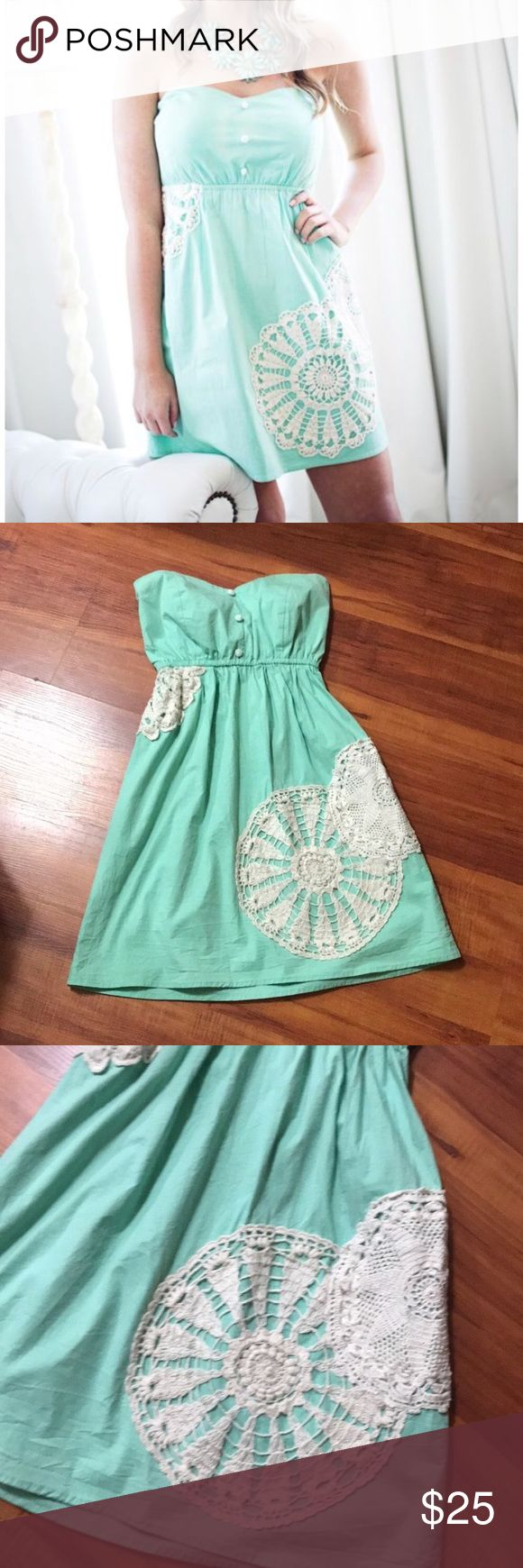 Judith March mint Strapless Dress Euc Small Judith March mint strapless dress with white/cream crochet designs in good used condition. No size tag so please look at the measurements: waist- 11 but stretches to 16 inches, length- 26.5 inches. Elastic waistline and ruching at the back. In my opinion, it would best fit an extra small/ small. Judith March Dresses Mini