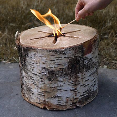 Bonfire Log. Take a crackling flame wherever you go with this portable bonfire log. Needing just a single match to light, each birch log is kiln-dried and finished with a braided handle for easy toting.