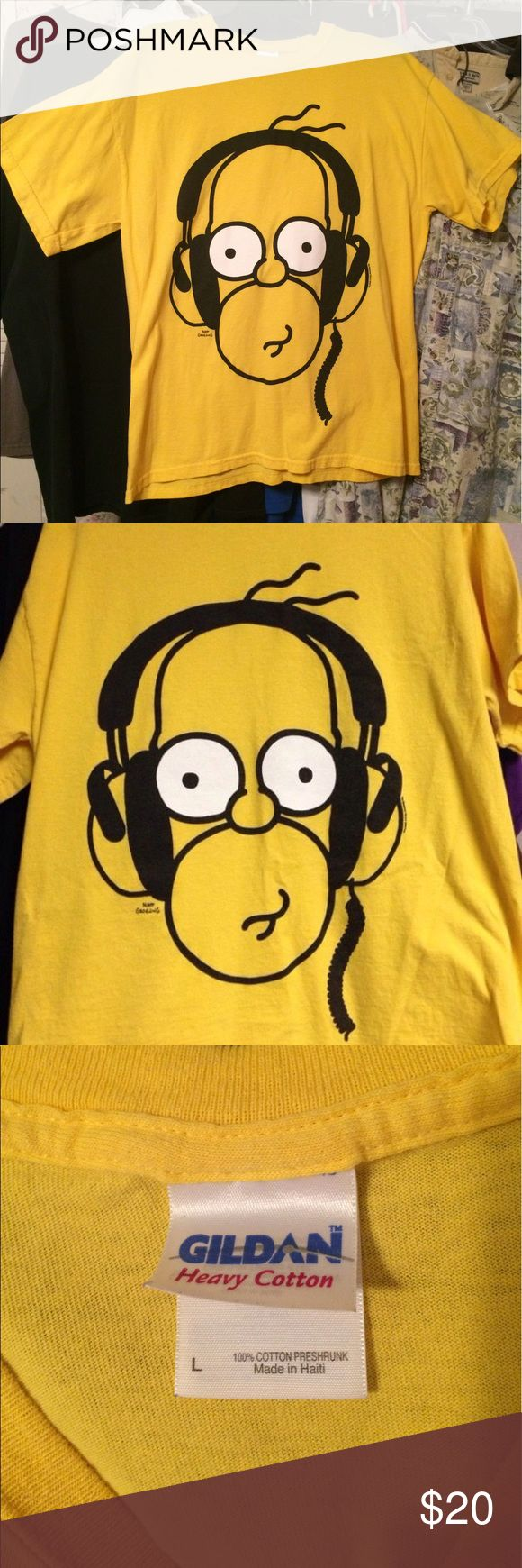 🎊new list!💛 Homer Simpson Tee💛 Homer Simpson tee.  Yellow.  Homer wearing headphones Image.  Size large.  A fan of the Simpsons?  Feel free to inquire regarding other Simpsons memorabilia available for sale. 😉 Gildan Shirts Tees - Short Sleeve