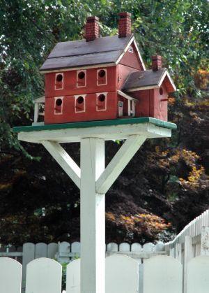 red farmhouse bird feeder