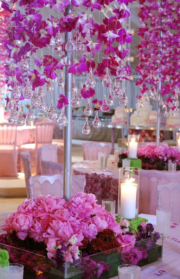 "Pink Floral Centerpiece with orchids & crystal ""teardrop"" hanging at the ends."