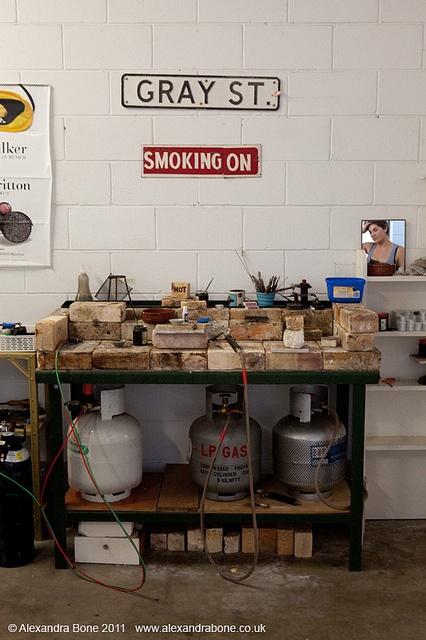 Alice Potter at Gray St. Workshop's soldering station.