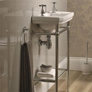 Cloakroom basins, try to get something with towel hanging yet slim for shower room