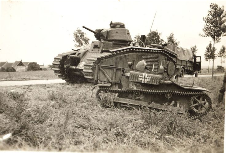 "Char B1 a French heavy tank manufactured before World War II. with a 75 mm howitzer in the hull; later a 47 mm gun in the turret was added, to allow it to function also as a Char de Bataille, a ""battle tank"""