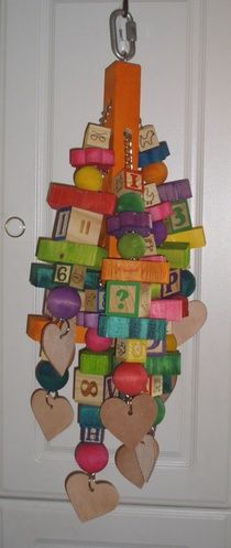 "Marvins Munchie    This toy is so big, it had to be put on chain. Toy measures around 24"" long and weighs 5 1/2 pounds. Made of 80 pieces of pine and other hardwoods with 10 large vegetable tanned leather hearts on five chains for a total of 10 hanging toys in one for hours of entertainment for your parrot. All wood pieces are dyed with food grade coloring. Recommended for the biggest chewers."