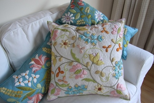 Pillows by Deborah Kemball...always drop dead gorgeous applique from this prolific quilter