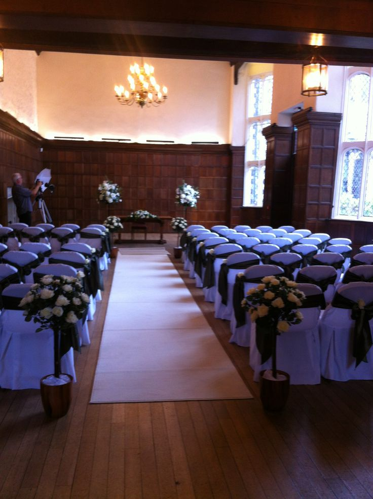The Great Hall fully dressed with optional aisle carpet and topiary.