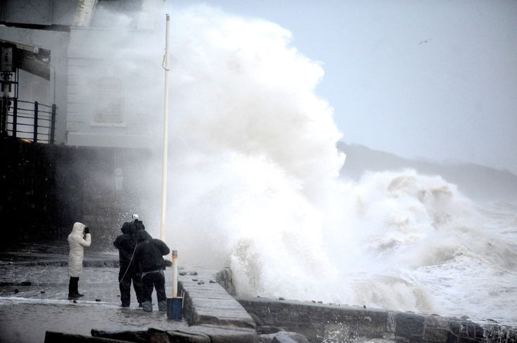 TV crews have been risking getting swept away to film the waves, which puts standing outside Finsbury Park station in a stiff breeze into perspective. | While Londoners Complain About A Tube Strike, The South West Appears To Have Been Washed Away