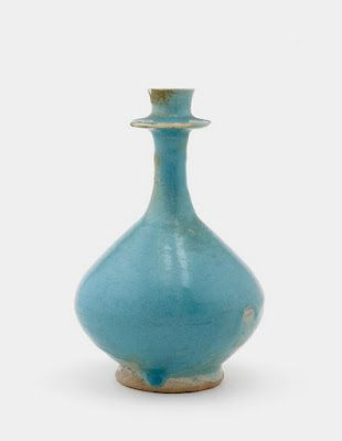 Bottle | Origin:  Iran | Period: 12th-13th century  Saljuq period | Details:  Not Available | Type: Earthenware with glaze | Size: H: 18.9  ...