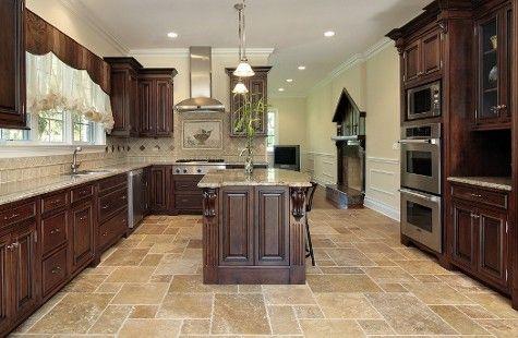 TOTAL DREAM kitchen... also like the travertine floors.