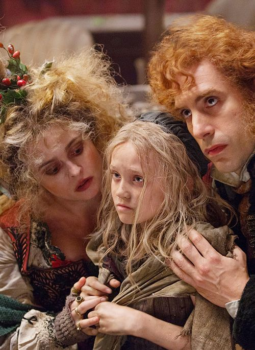 Les Mis (2012) | Helena Bonham Carter (Madame Thenardier), Isabelle Allen (young Cosette) and Sacha Baron Cohen (Thenardier) in the film adaptation of the musical Les Miserables.