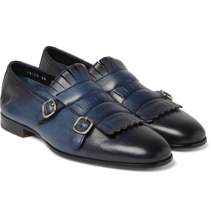 Dedicated to 'luxury, design and perfection', long-standing shoemaker <a href='http://www.mrporter.com/mens/Designers/Santoni'>Santoni</a> is proud of its heritage of craftsmanship and Italian excellence. Made from glossy burnished-leather, these rich navy shoes are detailed with elegant fringed kiltie panels and decorative monk straps. Try yours with tailored trousers and tonal socks for a sophisticated work or evening look.