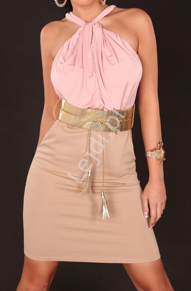 Dwukolorowa sukienka z różową górą i beżowym dołem oddzielona złotym paskiem. Sukienka z górą drapowaną i wiązaną na węzełek, z tyłu zapinana na guziczek. W pasie złoty szeroki pasek, podkreślający talię. Sukienka z obcisłym dołem o długości midi. Sukienka będzie idelana na codzień jak i do założenia na większe wyjścia. Z tego modelu dostępna również sukienka szmaragdowo beżowa. #sukienki #sukienka #modadamska