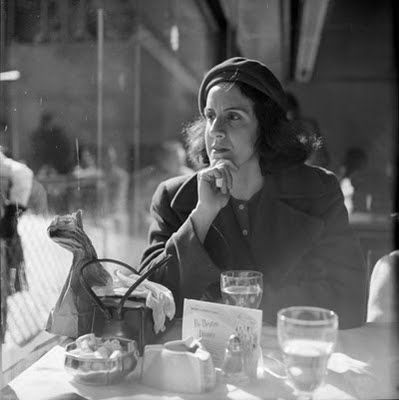 Wonderful shot by Vivian Maier. You just wonder what she is thinking.: