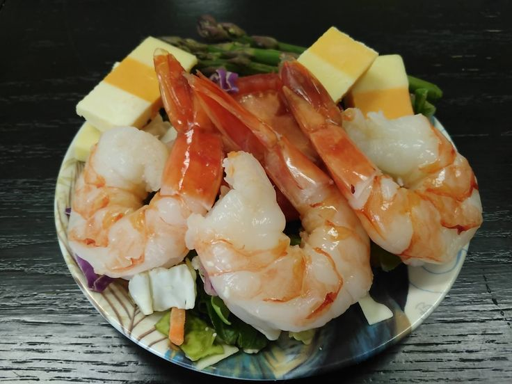 Colossal shrimp, green lettuce, asparagus, and cheese dinner