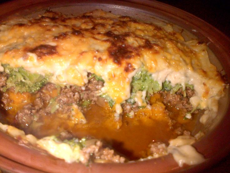 Mousake This is a Delish recipe that's layered as followers: cooked Butternut, Ground Beef (mince) - Cooked and seasoned well, Broccoli and topped with a White Sauce and covered with cheese.