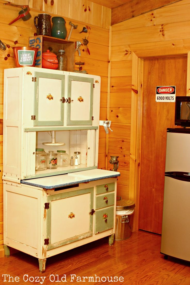 """A vintage Hoosier cabinet filled with lovelies was a great focal point.  Notice the sign on the storage room door??  Just plain fun and humorous.  Keep your eye peeled for plenty more humorous things.  If you're observant, you'll get a good laugh just like I did."" http://thecozyoldfarmhouse.blogspot.ca/2012/06/cutest-junkiest-vintage-cabinever.html#"