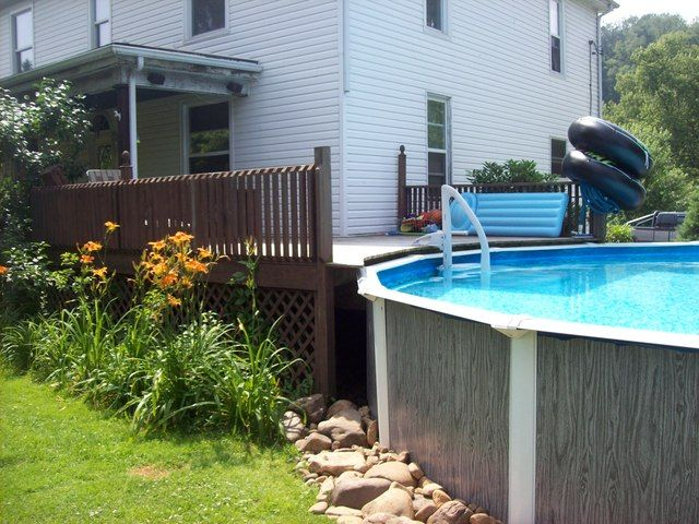 Above ground pools decks idea above ground pool deck for Pool deck landscaping