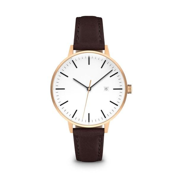 """The Minimalist"" watch by LINJER features a lacquered varnish dial and refined detailing. Rose gold case and mocha leather straps. 34mm"