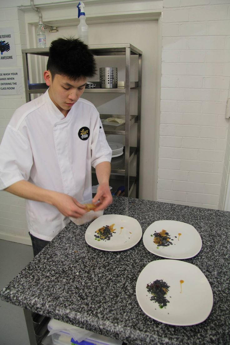 LuxBite plating his chocolate, pineapple and sea urchin dessert  #dessertdinner