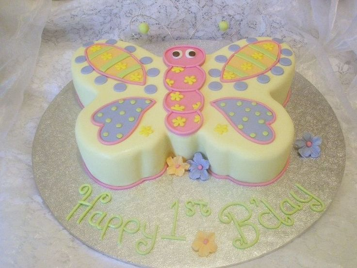 1st birthday cake for a little girl, all i was told on the phone was to make a butterfly cake, so this is it... chocolate cake, iced in gana...