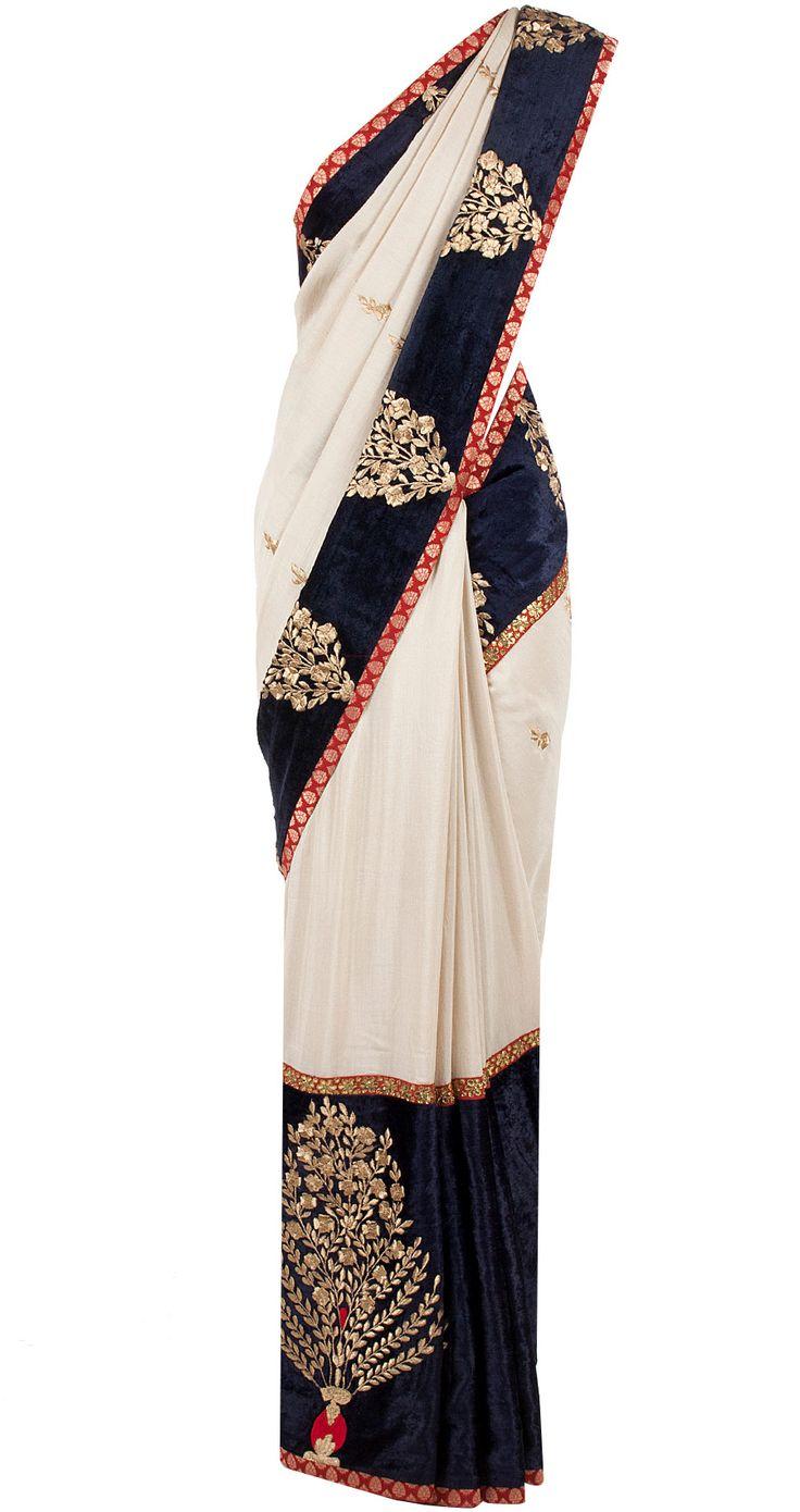 Beige and navy blue munga silk sari and gota patti blouse by SVA. Shop now at perniaspopupshop.com