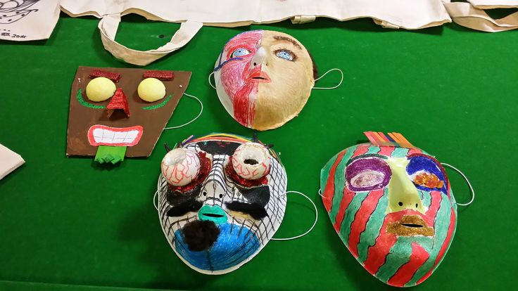 Colourful carnival masks make by Covance volunteers over the Summer