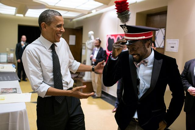 President Barack Obama talks with will.i.am, following an event The Ohio State University in Columbus, Ohio, Oct. 9, 2012.