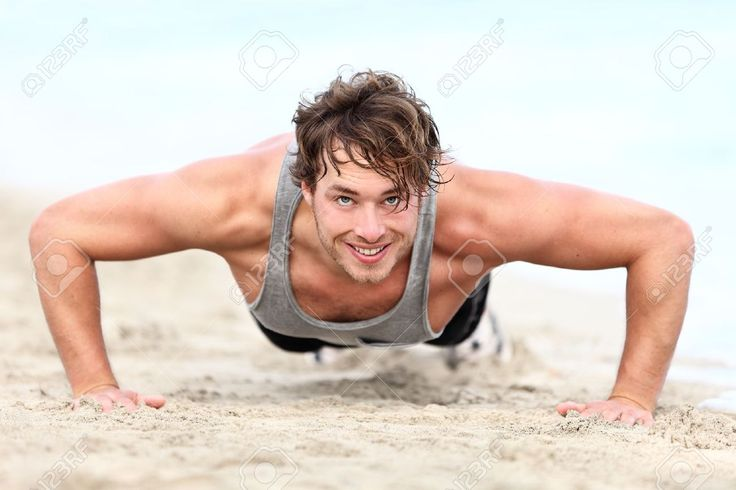 Fitness Man Exercising Push Ups Smiling Happy. Male Fitness Model ...