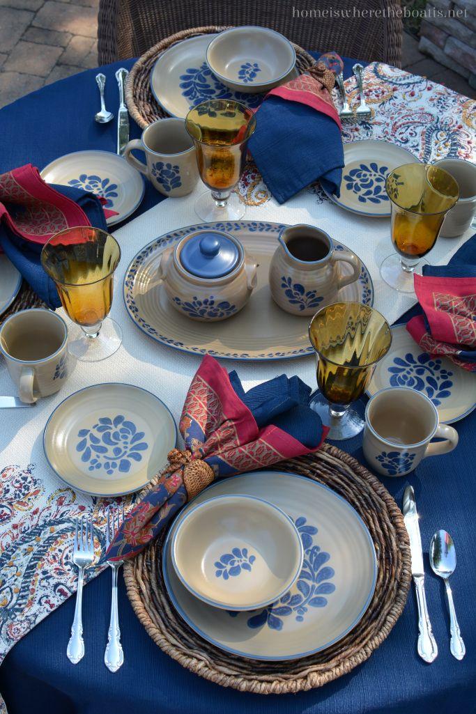 Transitional table with Pfaltzgraff Folk Art dinnerware…