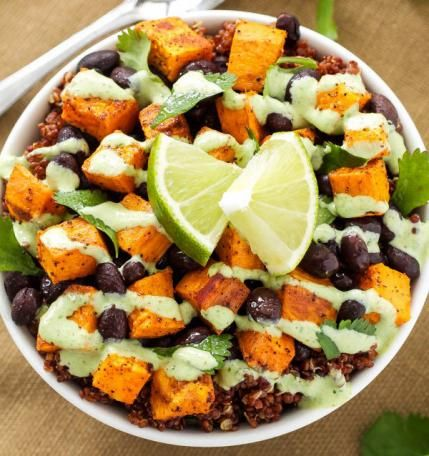 Sweet potato and black bean quinoa bowls are a delicious low-cholesterol recipe.
