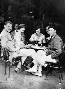 July 1925. Ernest Hemingway with Lady Duff Twysden, Hadley Hemingway (his first wife), and three unidentified people at a cafe in Pamplona, Spain (JFK Library).