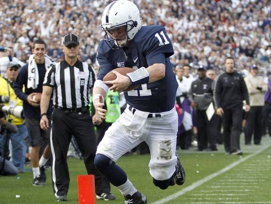 PENN STATE – FOOTBALL 2012 – Penn State quarterback Matt McGloin scores a touchdown on a 5-yard run in the fourth quarter to beat Northwestern.