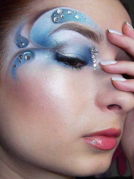 Artistic swirled eye shadow in shades of blue accented with crystals, titled 'Blue Lagoon'.