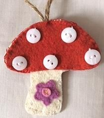 Felt mushroom w buttons, made by Gréta