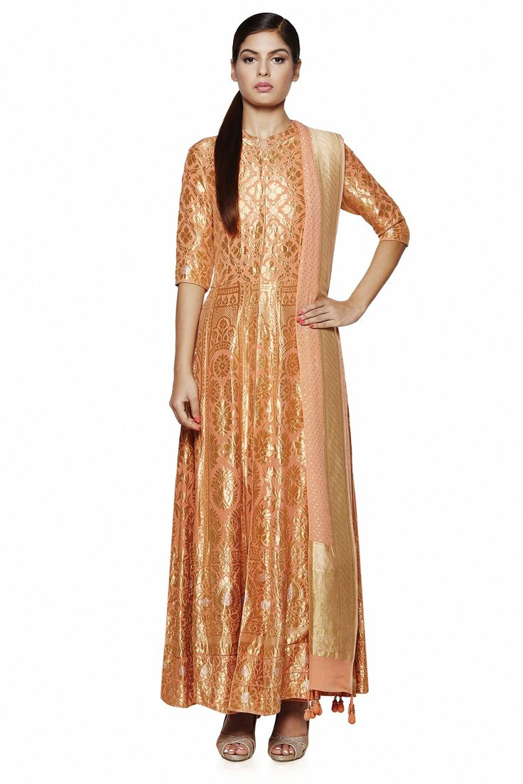 Featuring an elegant,  contemporary banaras hand woven suit  in peach . Pair this ensemble with studded earrings or a statement ring for a simple, gorgeous look.INR 100,000.00