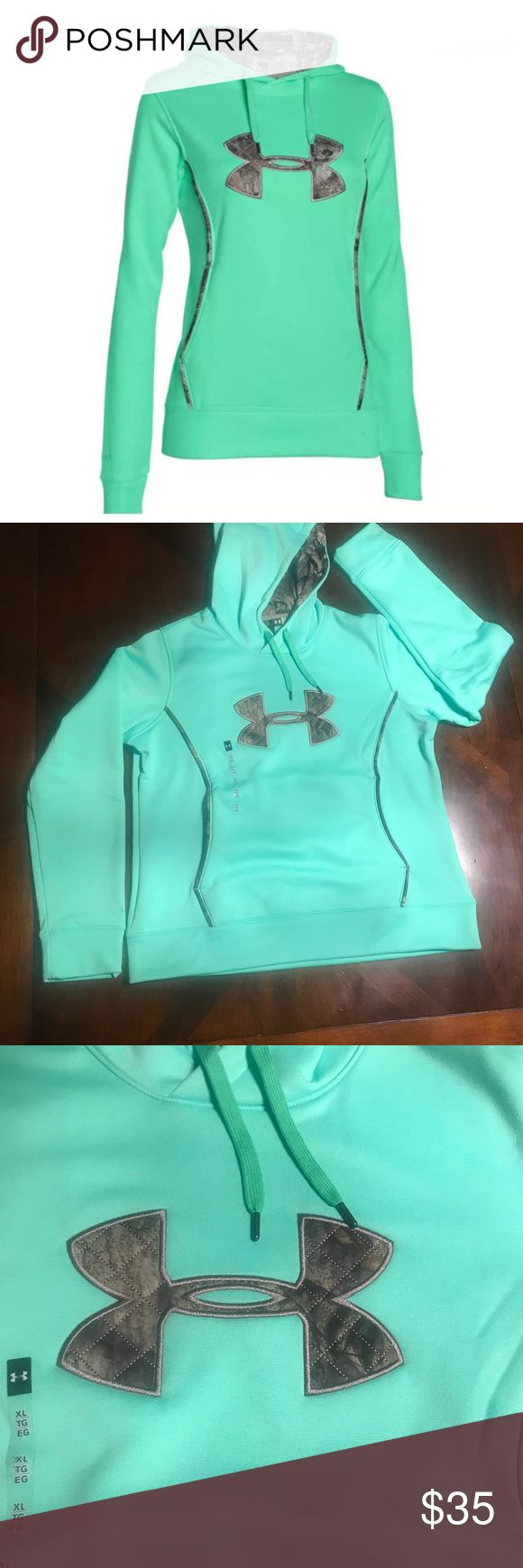 """UA Mint Green Women's Camo Hoodie Under Armour Women's water resistant 💦💧 Storm Style  Color: Mint Green  Hand Warmer Kangaroo pocket with camo piping detail  Camouflage hoodie  Size XL armpit to armpit 22"""" Length from top shoulder to bottom waist hem 26.5"""" Fleece fabric  Adjustable 3pc hood with crossover neck and pop color lining   **this color is a beauty**😍 Under Armour Tops Sweatshirts & Hoodies"""