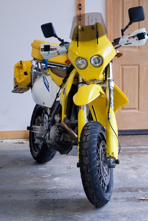 Britannia Composite's Lynx fairing installed on 2006 DRZ400SM.  Fairing consists of Hella headlights, adjustable windscreen and dash for mounting instrumentation.  Low beam has been upgraded to HID whereas high beam was left as 55 watt halogen.