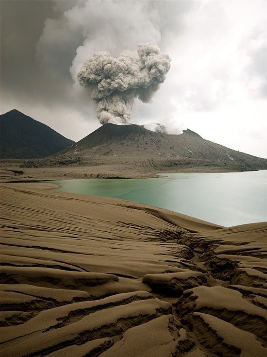 """""""Rabaul volcano is one of the most active and most dangerous volcanoes in Papua New Guinea.   Rabaul exploded violently in 1994 and devastated the lively city of Rabaul. Since then, the young cone Tavurvur located inside the caldera has been the site of near persistent activity in form of strombolian to vulcanian ash eruptions."""""""